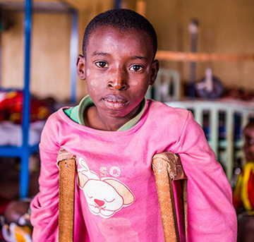 A young Burundian heals in a hospital ward that may house up to three patients per bed. In the boy's entire country, outside the capital city the only treatment for leg fractures is at Kibuye Hope Hospital. The L'Chaim Prize will help doctors keeps more Burundians on their feet.